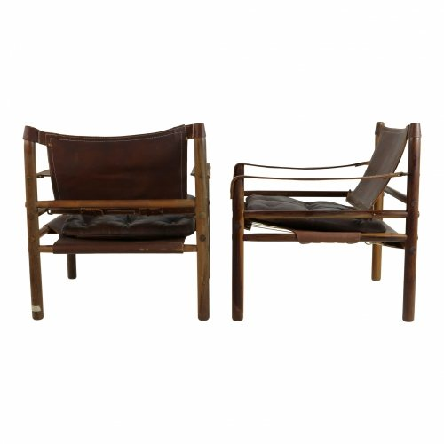 Set of two Sirocco safari chairs by Arne Norell with loose leather cushion