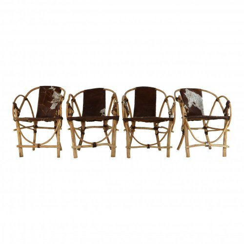 Four special handmade armchairs cow skin seating and back