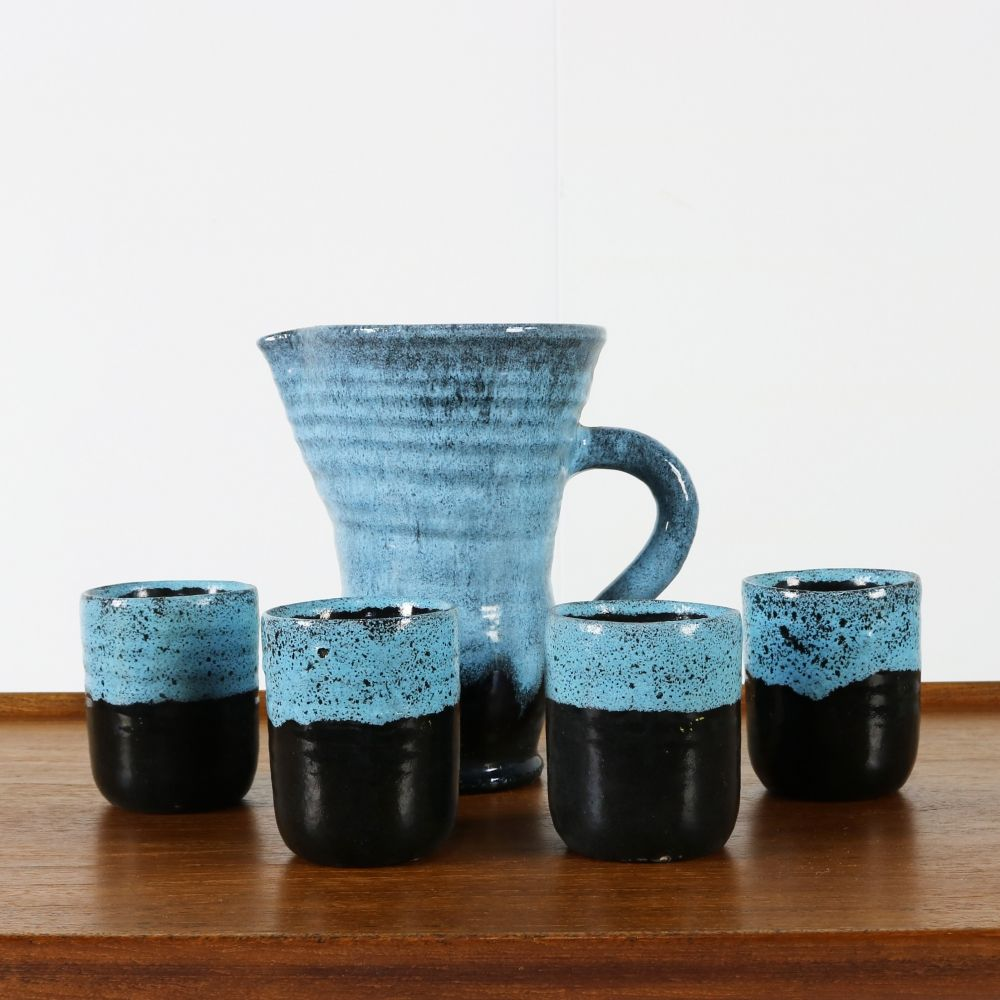 Nice ceramic pitcher with four mugs