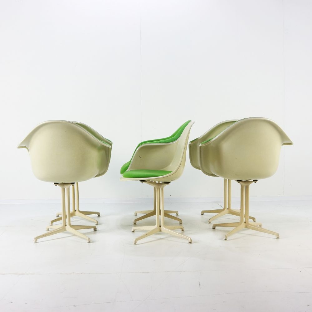 La Fonda DAL Eames shell armchairs and a side chair
