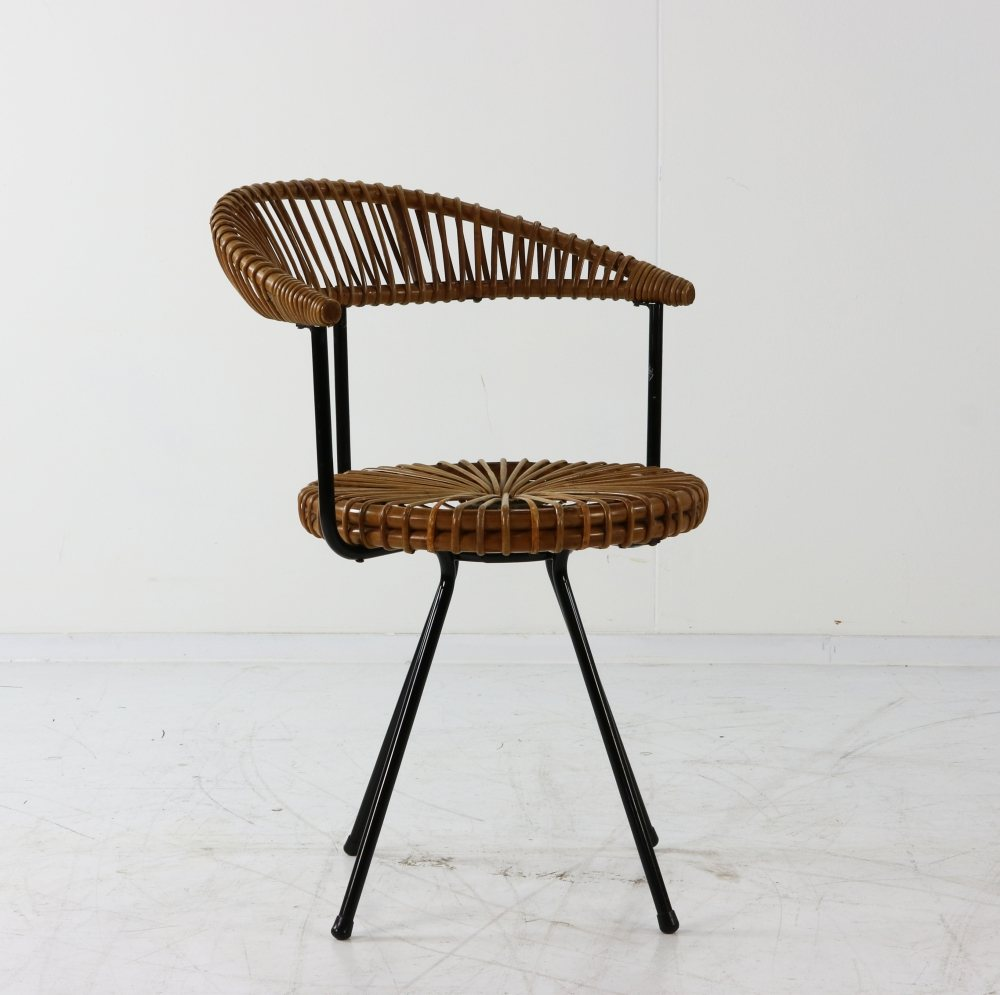 Typical fifties ratan stool with backrest