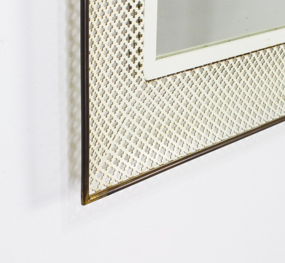 German design wall mirror with perforated metal frame