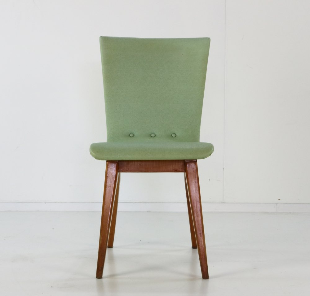 Five originally upholstered Swing Van Os dining chairs