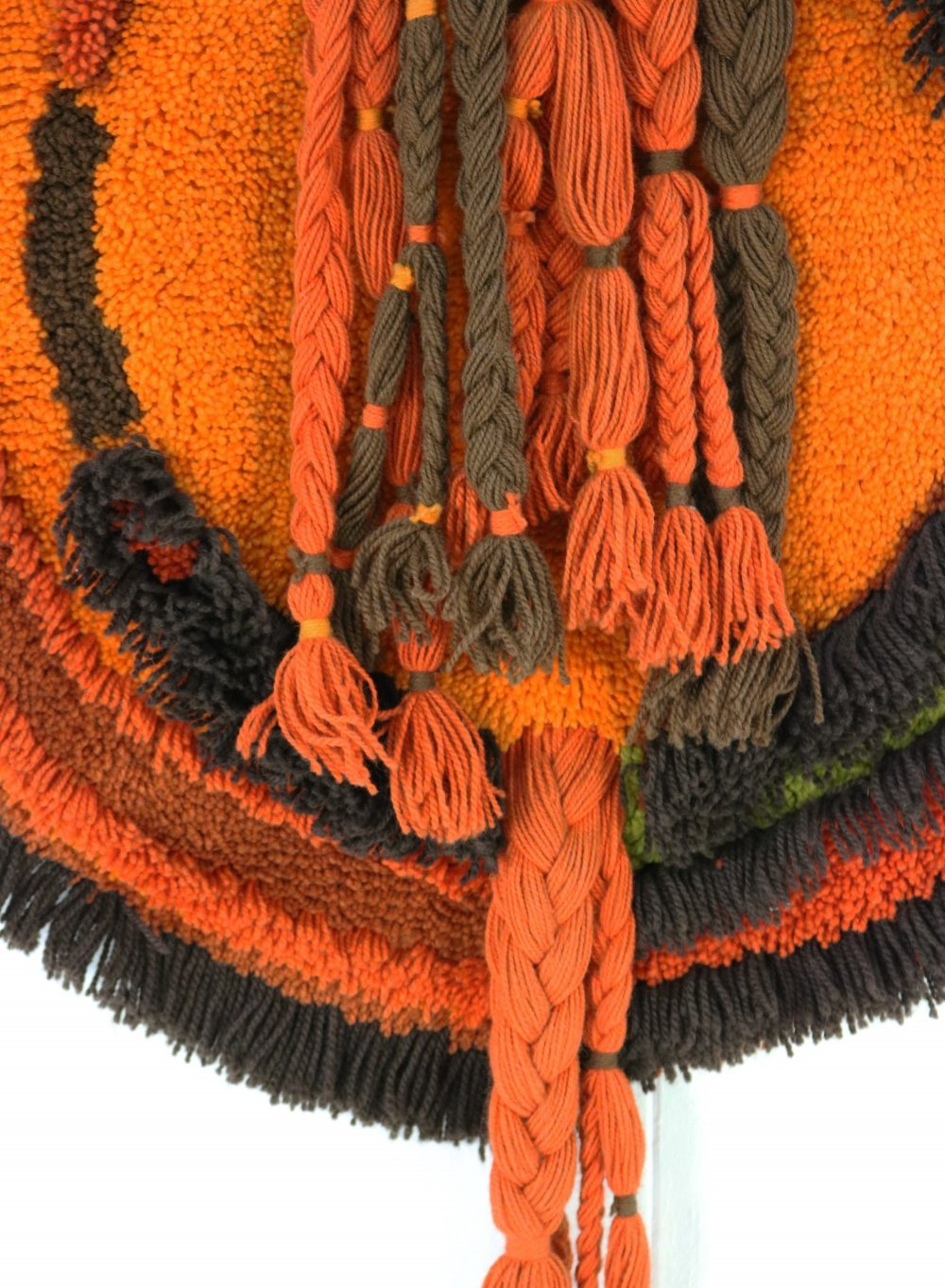 Wool wall carpet decoration in orange colors