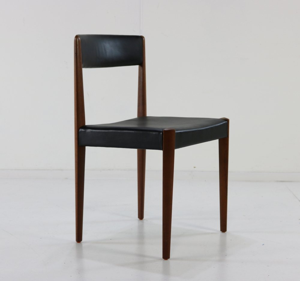 Five teak and black leather Danish design dinner chairs
